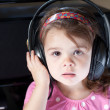 Child wearing headphones — Stock Photo
