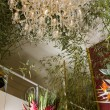 Interior of exotic flower shop with precious crystal chandelier — Stock Photo