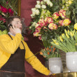 Florist accepting phone order from a customer — Stock Photo