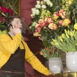 Florist accepting phone order from customer — Stock Photo #10050802