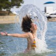Girl splashing out of the water — Stock Photo