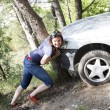 Girl pushes car — Stock Photo