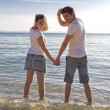 Attractive young couple on beach — Stock Photo