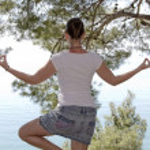 Girl performing yoga near the sea — Stock Photo #10542876