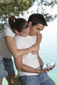 Young happy couple with new tablet — Stock Photo