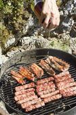 Pouring beer to make BBQ crispier — Stock Photo