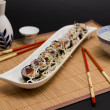 Sushi and soy sauce with sake and served with chopsticks — Stock Photo