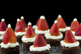 Perspective of Santa hat brownies on black background — Stock Photo