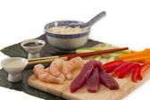 Sushi ingredients, soy sauce, wasabi with sake and served with chopsticks, — Stock Photo