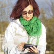 Good looking mid age woman with tablet phone — Stock Photo