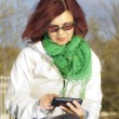Stock Photo: Good looking mid age woman with tablet phone