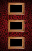 Frame on red wall — Stock Photo