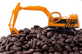 Backhoe and coffee beans — Stock Photo