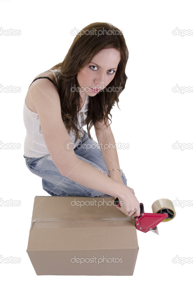 Attractive beautiful woman putting tape on cardboard moving storage boxes parcels — Stock Photo #10470599