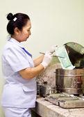 Nurse sterilize medical instruments — Stock Photo