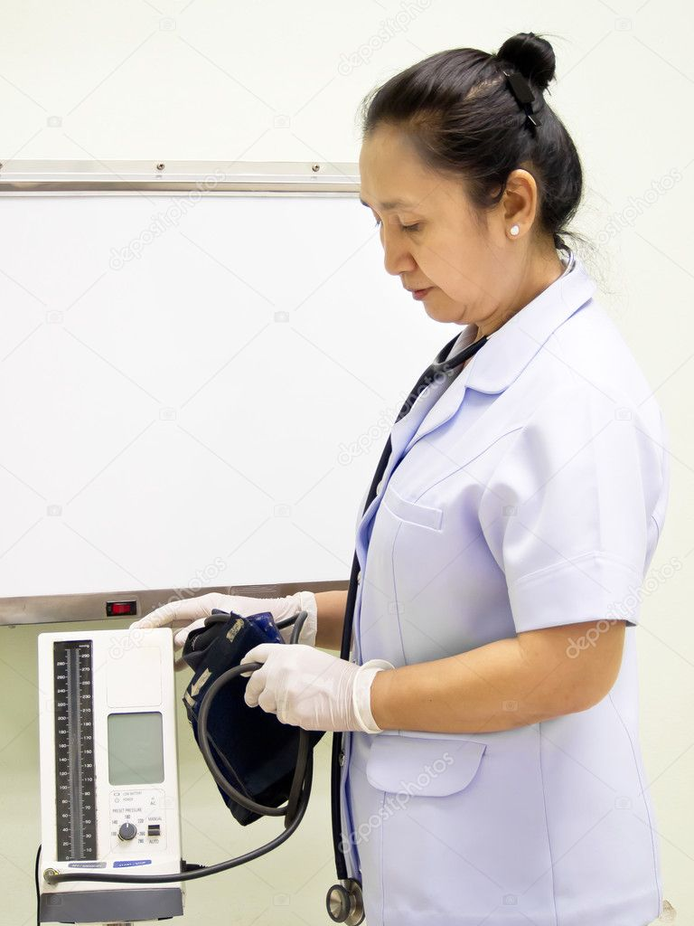 Nurse with blood pressure meter — Stock Photo #10111352