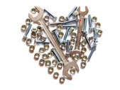 Assorted wrench,nuts and bolts heart on white background — Stock Photo