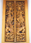 Thai molding art on door of the temple — Stock Photo