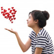 Romantic young woman holding a red heart in hands — Stock Photo #9877537
