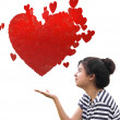 Romantic young woman holding a red heart in hands — Stock Photo #9877544