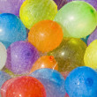 Rainwater over colored balloons — Stock Photo