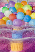 Water filled colored balloons — Stock Photo