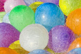 Rainwater falling over colored balloons — Stockfoto