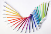 Dancing colored pencils — Stock Photo