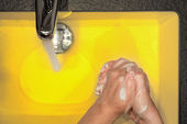 Hand washing in yellow — Stock Photo