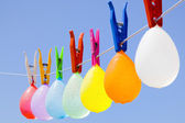 Hanging colored balloons — Stock Photo