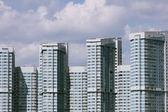 Blue and white multifamily housing — Stock Photo