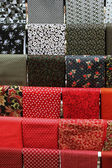 Red and black samples of cotton fabric for toysc — Stock Photo