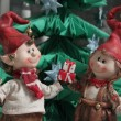 Christmas elfs boy and girl giving a present under christmas tre — Stock Photo #8944078