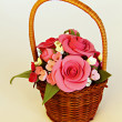 Handmade basket with artificial flowers (roses and tulips) — Stock Photo #8970869
