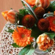 Beautiful spring orange bunch of flowers left — Stock Photo