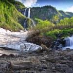 Waterfall snow mountain. Russia, Kavkaz — Stock Photo #9370515