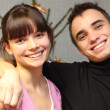 Stock Photo: Portrait of beautiful smiling teenagers couple