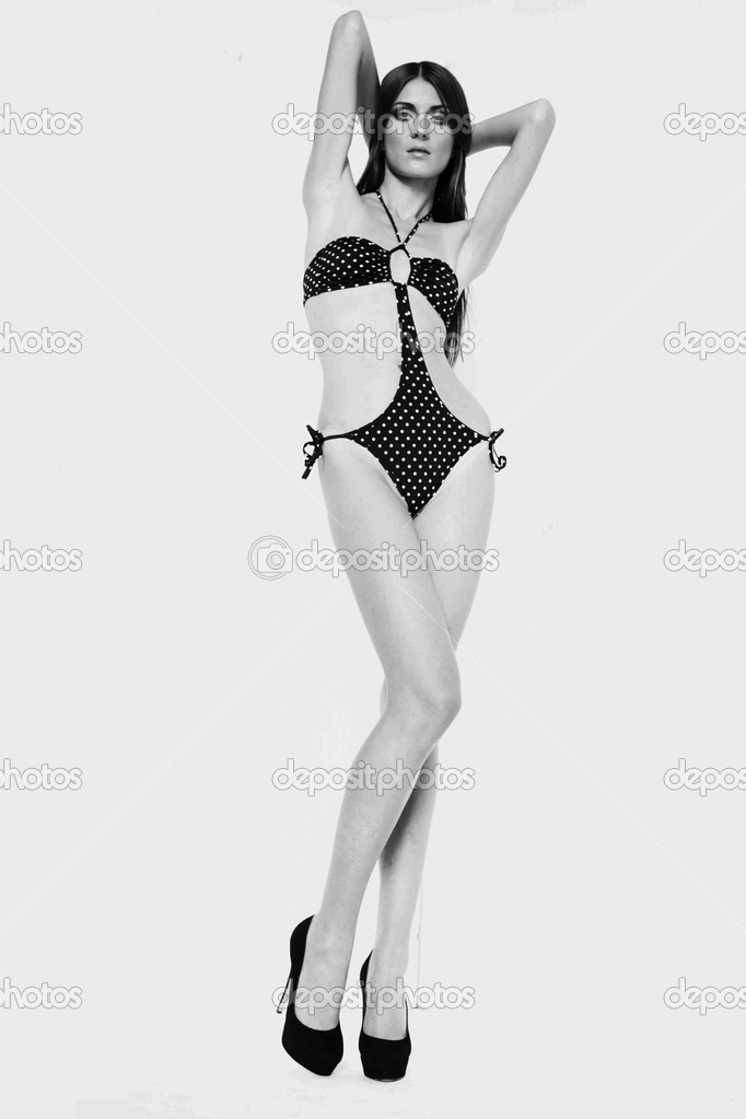 Studio shot of beautiful shape woman in swimsuit with long legs