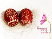 Easter traditional eggs in the hay and wishes — Stock Photo