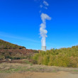 Stock Photo: Geothermal energy. Cooling tower in green valley.