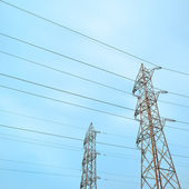 Two transmission towers, also known as electricity pylons. — Stock Photo
