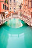 Venice, Bridge on water canall. Long exposure photography. — Stock Photo