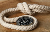 Marine rope and compass — Stock Photo