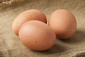 Eggs on sacking — Stock Photo