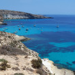 Boats on the island of rabbits- Lampedusa, Sicily - Stok fotoğraf