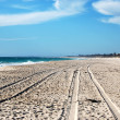 Stock Photo: Car track on white sand beach
