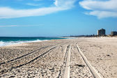 Car track on white sand beach — Stock Photo