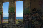 Ocean view from the window of abandoned power station — Stock Photo