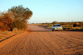Car at the gravel road — Stock Photo