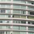 Apartment building showing lots of windows — Stock Photo #9621692